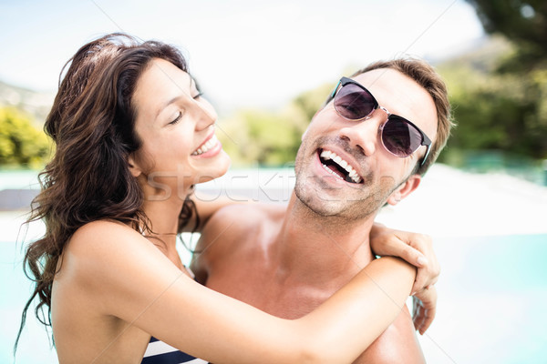 Young couple cuddling each other near pool Stock photo © wavebreak_media
