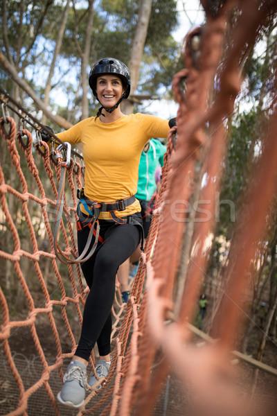 Woman walking on rope bridge Stock photo © wavebreak_media