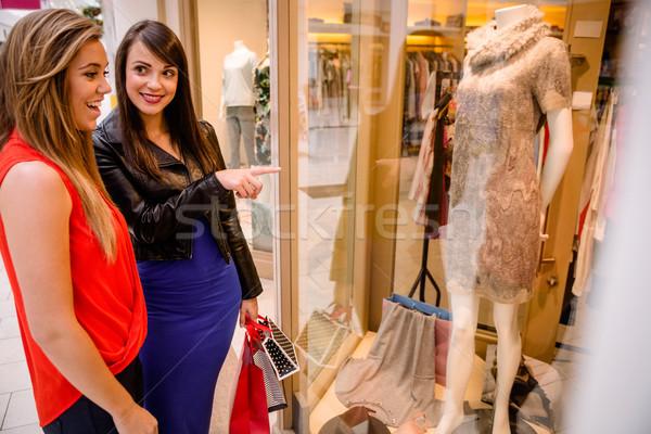 Two beautiful women window shopping in mall Stock photo © wavebreak_media