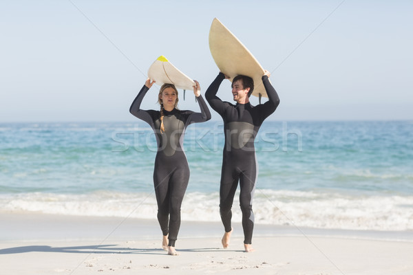 Felice Coppia tavola da surf testa spiaggia Foto d'archivio © wavebreak_media