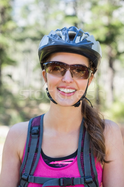 Portrait of beautiful woman wearing helmet Stock photo © wavebreak_media