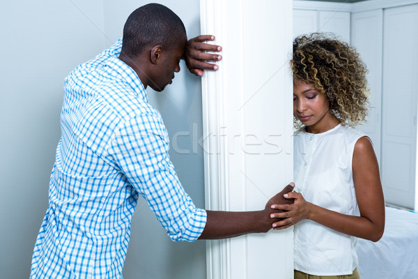 Upset couple standing on opposite sides of the wall Stock photo © wavebreak_media
