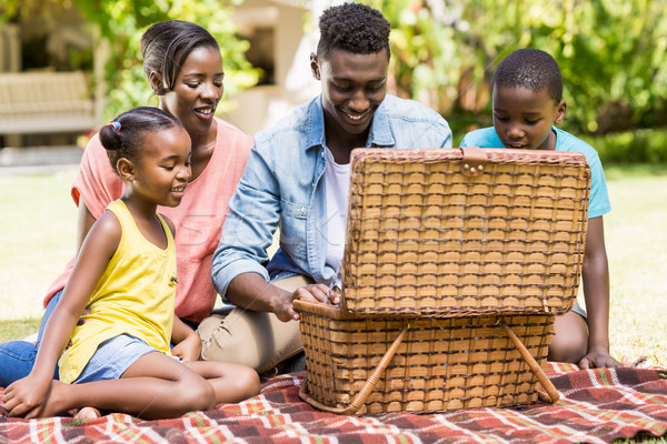 Happy family looking the wicker basket Stock photo © wavebreak_media