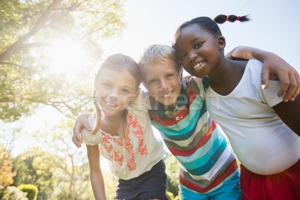 Gyerekek pózol együtt napos idő kamera park Stock fotó © wavebreak_media