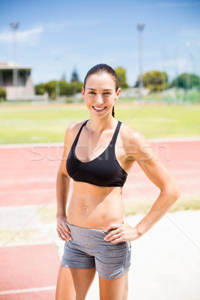 Portret vrouwelijke atleet permanente handen heupen Stockfoto © wavebreak_media