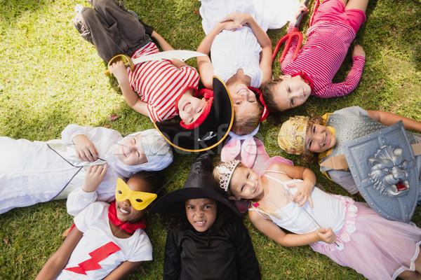 Heureux enfants herbe parc femme foule Photo stock © wavebreak_media
