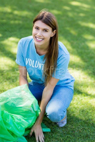 Portrait of volunteer woman collecting rubbish Stock photo © wavebreak_media