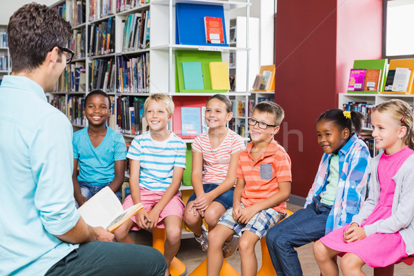 Teacher teaching kids in library Stock photo © wavebreak_media