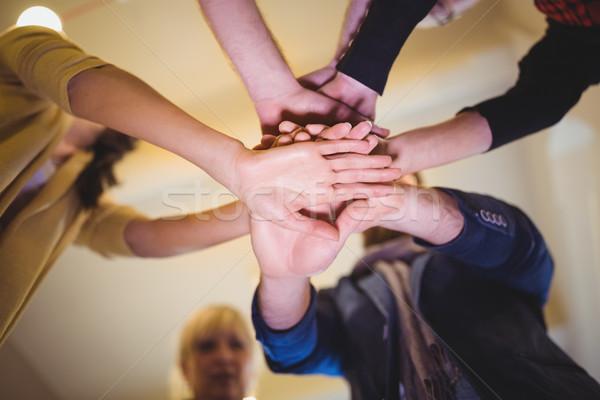 Creative business people stacking hands in office Stock photo © wavebreak_media