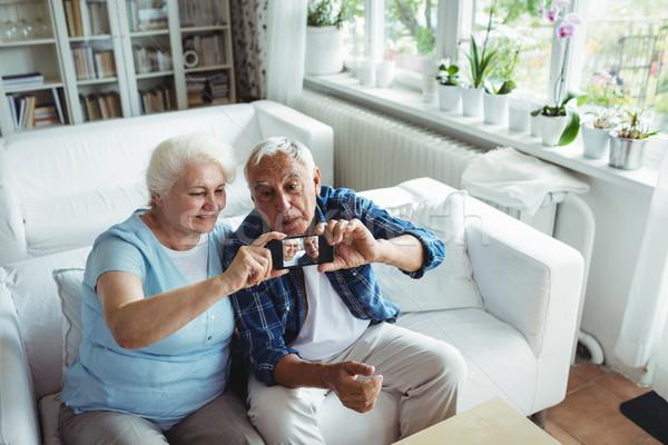 Senior couple taking a photo from mobile phone Stock photo © wavebreak_media