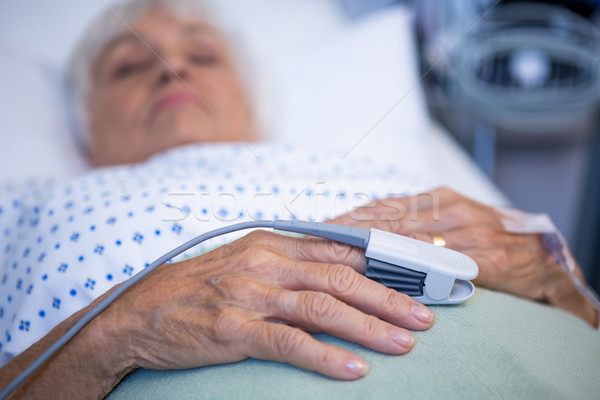 Finger clip on patients hand to monitor pulse Stock photo © wavebreak_media