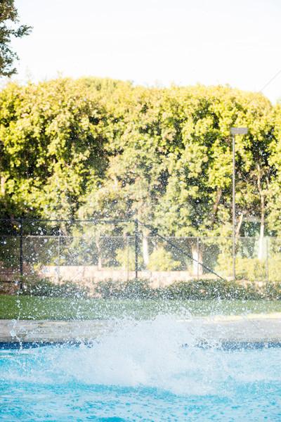 Pure water splashing in the pool Stock photo © wavebreak_media