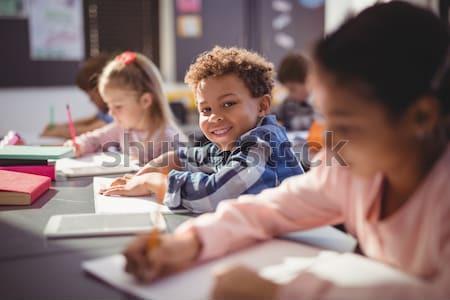 Portrait souriant écolier devoirs classe école Photo stock © wavebreak_media