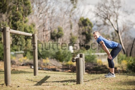 Woman jumping over the hurdles during obstacle course Stock photo © wavebreak_media