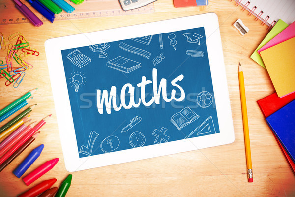 Maths against students desk with tablet pc Stock photo © wavebreak_media