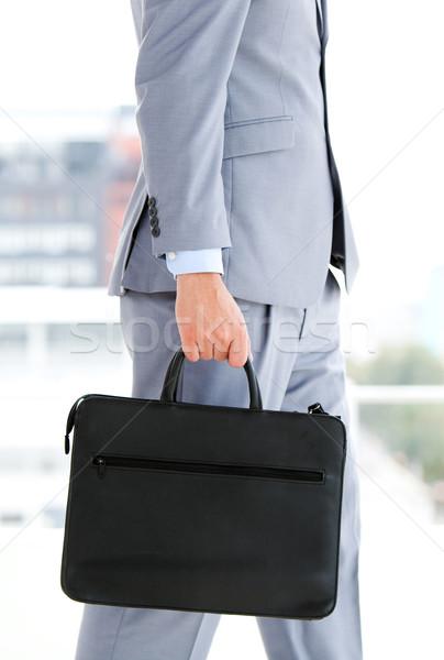 Businessman holding a briefcase Stock photo © wavebreak_media