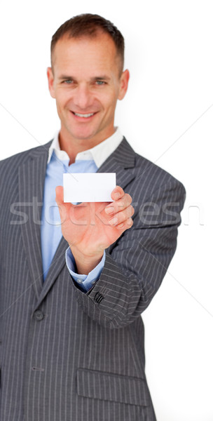 Smiling assertive businessman showing a white card  Stock photo © wavebreak_media