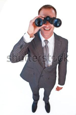 Self-assured businesswoman looking through binoculars  Stock photo © wavebreak_media