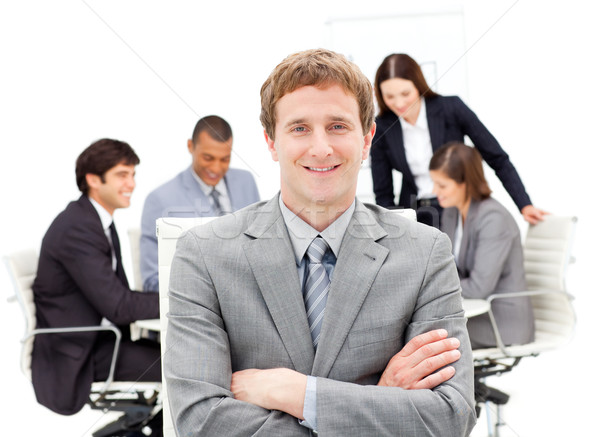 Assertive male executive with folded arms sitting in front of hi Stock photo © wavebreak_media