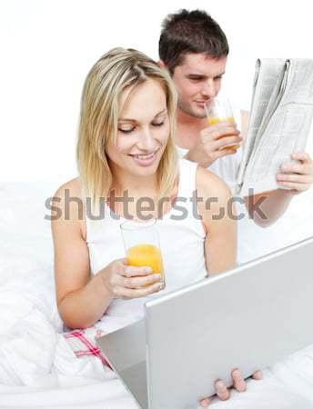 Lovers reading a newspaper and drinking orange juice Stock photo © wavebreak_media