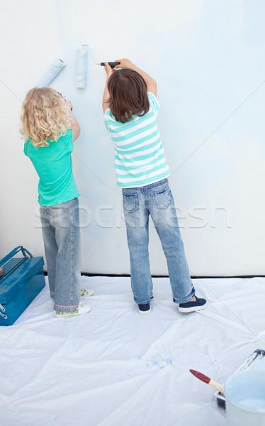 Irmãos pintura parede casa menina Foto stock © wavebreak_media