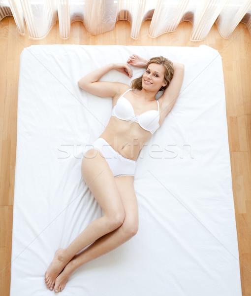 Delighted woman in underwear lying  Stock photo © wavebreak_media