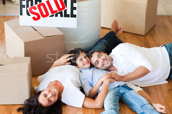 Parents and son moving house lying on floor Stock photo © wavebreak_media