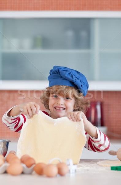 Young boy baking in a kitchen Stock photo © wavebreak_media