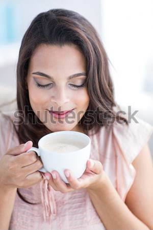 Beautiful woman drinking a cup of tea  Stock photo © wavebreak_media