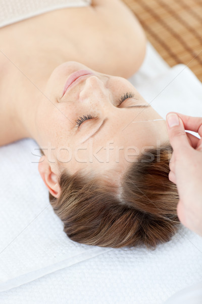 Acupuncture needles on a cauasian woman's head  Stock photo © wavebreak_media