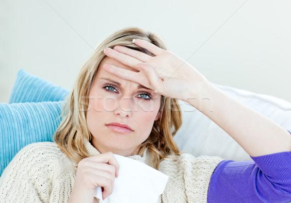 Kobieta sofa uczucie temperatura biały tle Zdjęcia stock © wavebreak_media