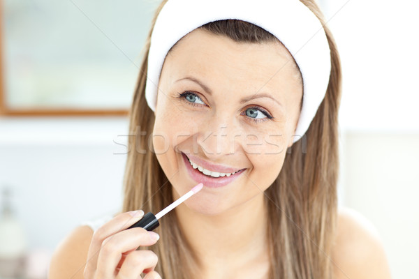 Mulher lustro lábios banheiro casa Foto stock © wavebreak_media