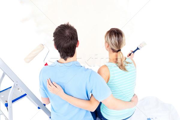 Cariñoso Pareja pintura habitación casa Foto stock © wavebreak_media