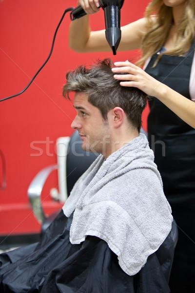 Female hairdresser drying her male customer's hair in her salon Stock photo © wavebreak_media