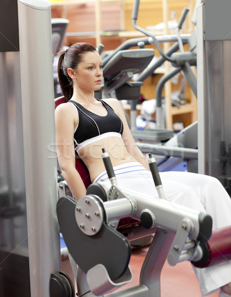 Attractive woman lifting weights with a leg press in the room of a sport centre Stock photo © wavebreak_media