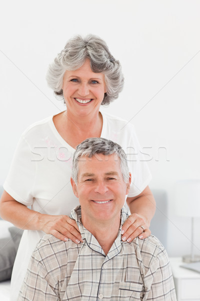 Retired woman giving a massage to her husband at home Stock photo © wavebreak_media