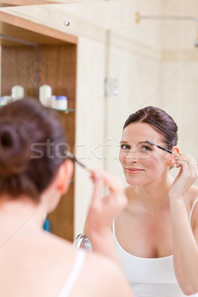 Kobieta rzęsy strony uśmiech oka kobiet Zdjęcia stock © wavebreak_media