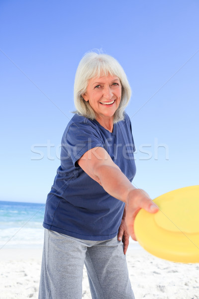 Elderly woman playing freesby Stock photo © wavebreak_media