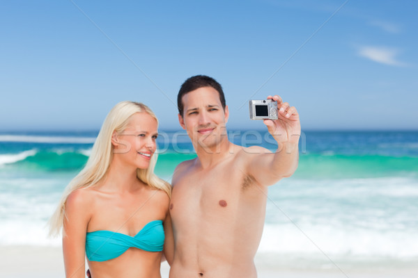 Couple taking a photo of themselves Stock photo © wavebreak_media