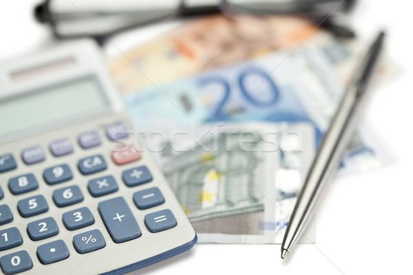 Money, pen, glasses and angled pocket calculator on a white background Stock photo © wavebreak_media