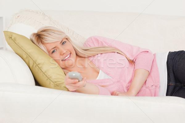Vonzó szőke nő női pózol kanapé nappali Stock fotó © wavebreak_media