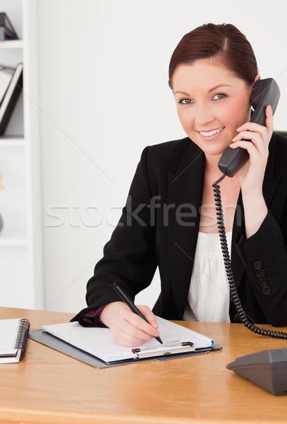 Jovem boa aparência mulher terno escrita bloco de notas Foto stock © wavebreak_media