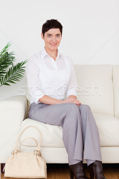 Charming short-haired woman sitting on a sofa in a waiting room Stock photo © wavebreak_media