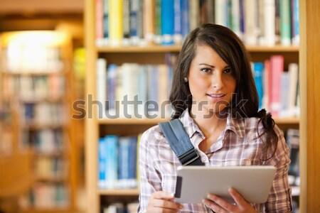 Cute jungen Studenten Tablet-Computer Bibliothek Computer Stock foto © wavebreak_media