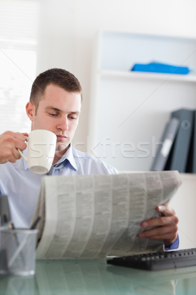 Young businessman reading the newspaper and having a coffee Stock photo © wavebreak_media