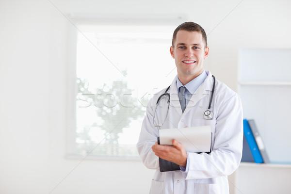 Smiling doctor having good news for his patient Stock photo © wavebreak_media