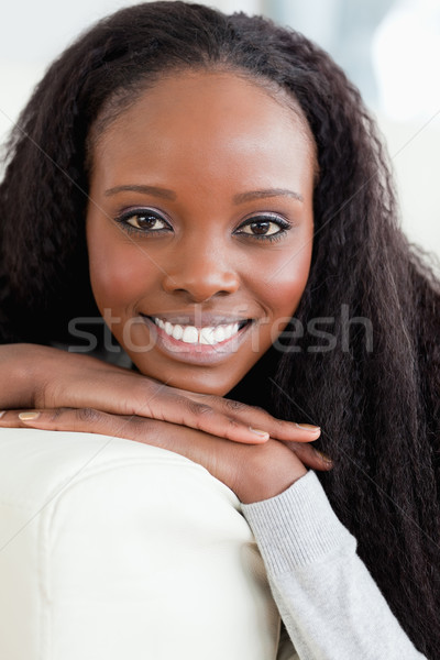 Close up of smiling young woman lying on the sofa Stock photo © wavebreak_media