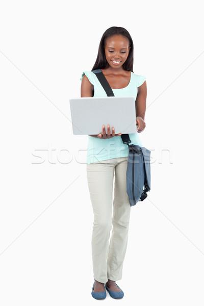 Gülen genç öğrenci dizüstü bilgisayar beyaz kitap Stok fotoğraf © wavebreak_media