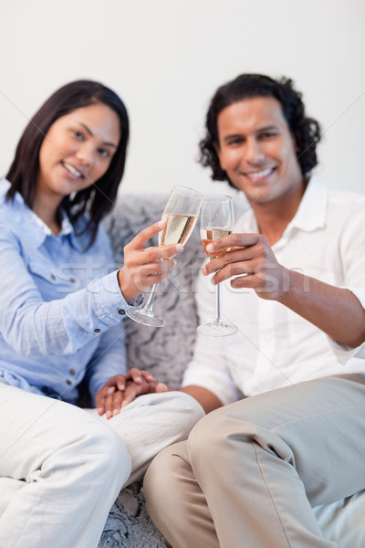 Young couple celebrating with sparkling wine in the living room Stock photo © wavebreak_media