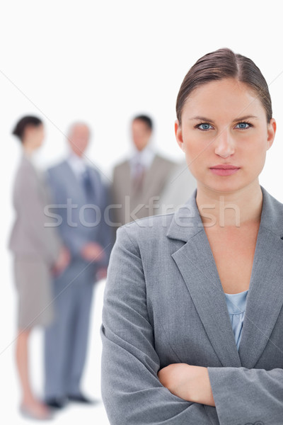 Serious businesswoman with her colleagues behind her against a white background Stock photo © wavebreak_media